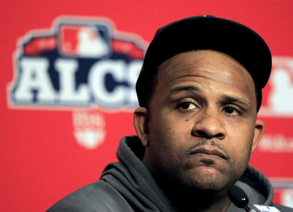 CC Sabathia listens to a question during a