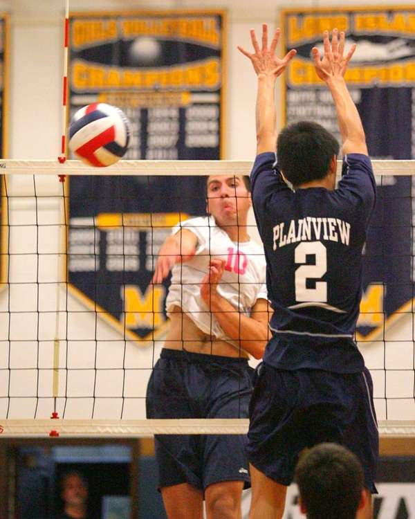 Massapequa's Steven Woessner drills a spike past Plainview