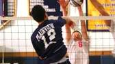 Massapequa's Nicholas Smith blocks a spike that was