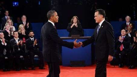 President Barack Obama shakes hands with Republican presidential