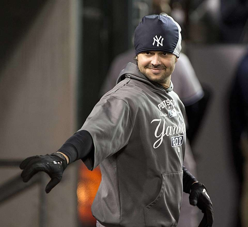 Yankees' Nick Swisher in the dugout dressed but