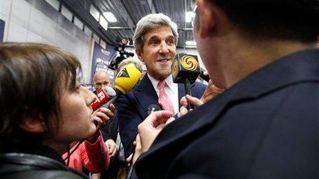 Sen. John Kerry, D-Mass., speaks to reporters in