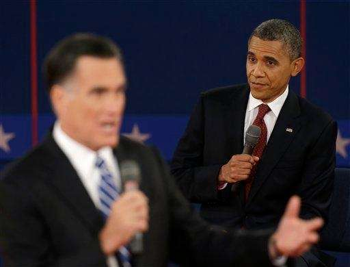 President Barack Obama listens as Republican presidential nominee