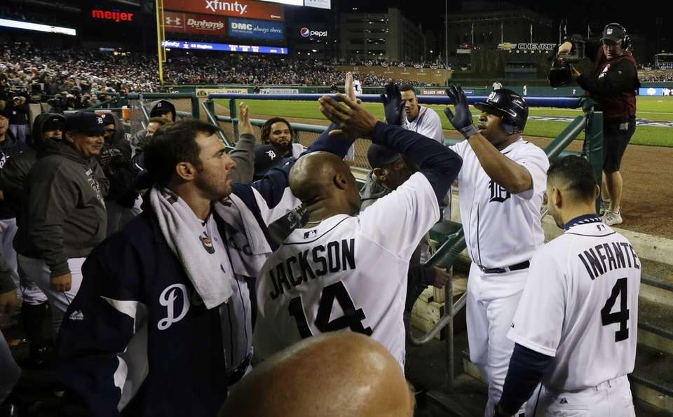 Delmon Young is congratulated by teammates after hitting