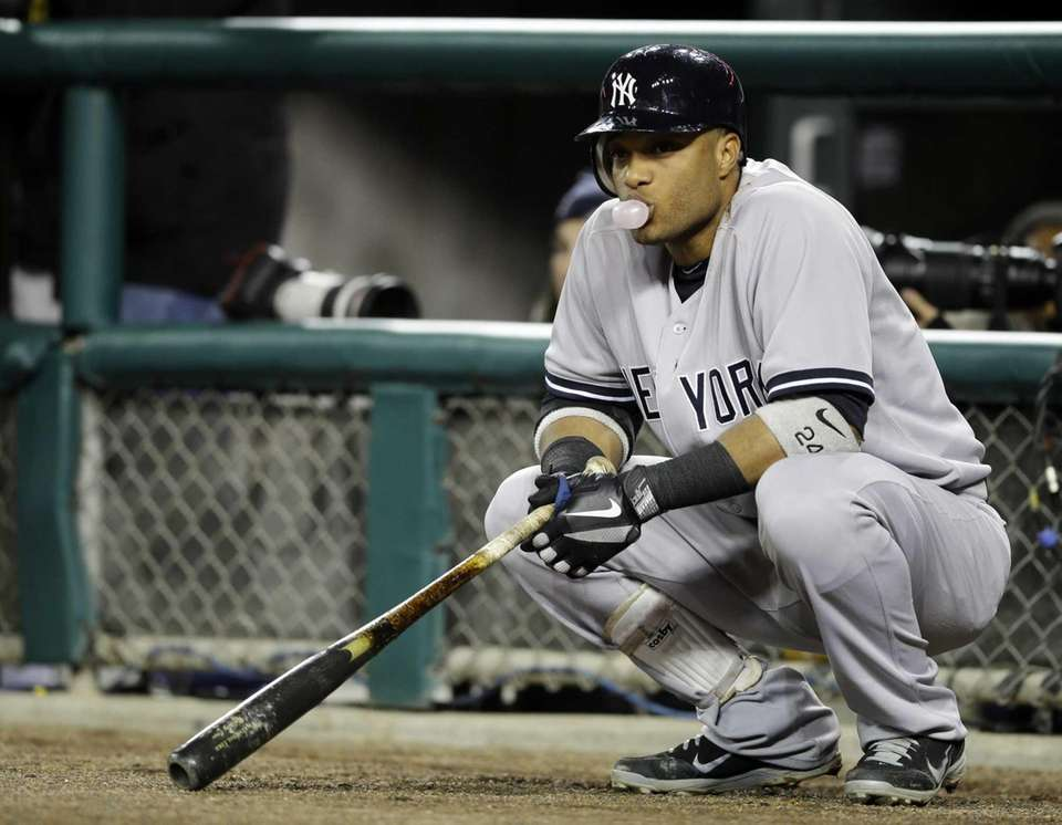 Robinson Cano waits to hit in the fourth