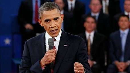 President Barack Obama answers a question during the