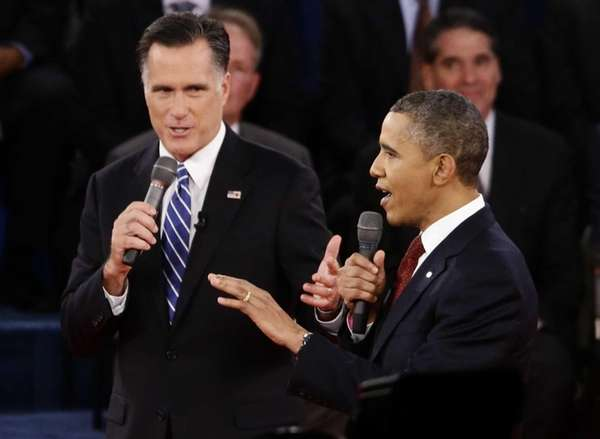 Mitt Romney and President Barack Obama speak during