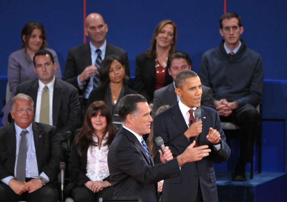 President Barack Obama and Mitt Romney speak during