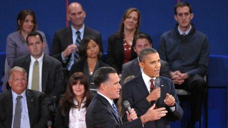President Barack Obama and Mitt Romney speak during