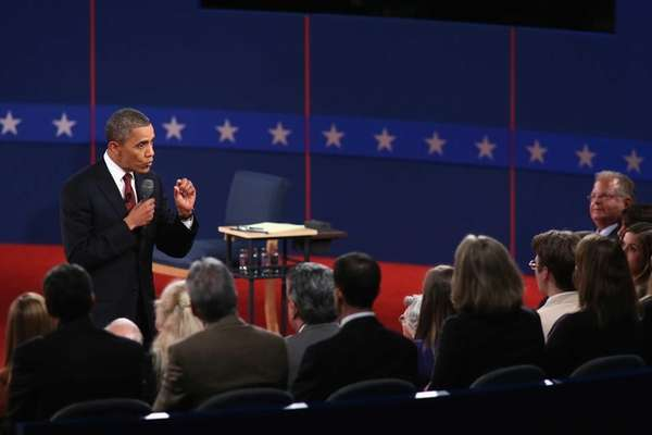 President Barack Obama, left, answers a question during