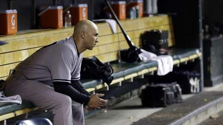 New York Yankees' Raul Ibanez sits on the