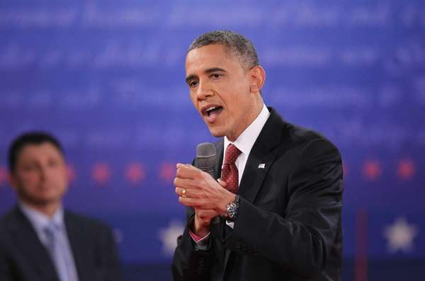President Barack Obama answers a question during a