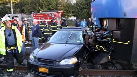 A train struck a car in Patchogue, police
