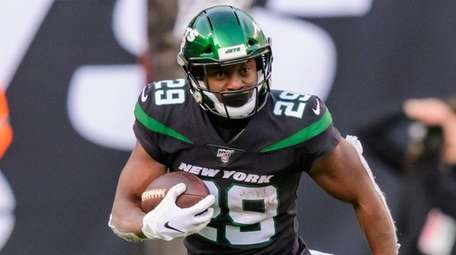 Jets running back Bilal Powell rushes against the
