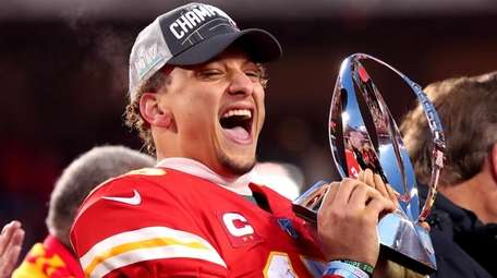 Patrick Mahomes of the Chiefs holds up the