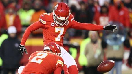 Harrison Butker of the Chiefs kicks a field