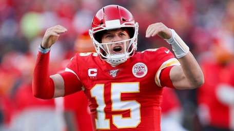 The Chiefs' Patrick Mahomes reacts after throwing a