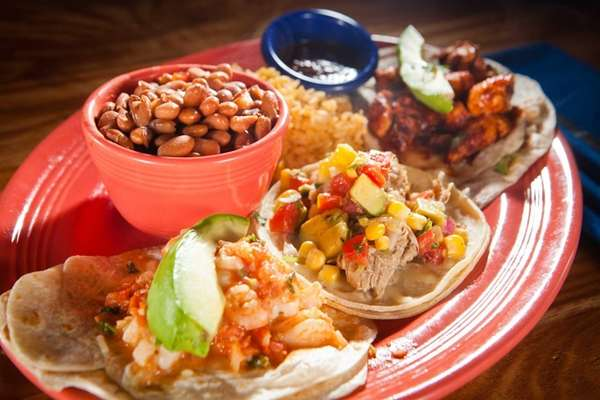 A Cozymels combination plate with three tacos --