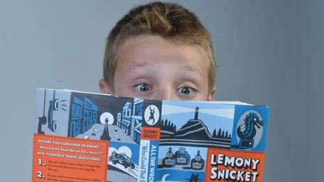 Ryan O'Halloran, 10, of Amityville reads a Lemony
