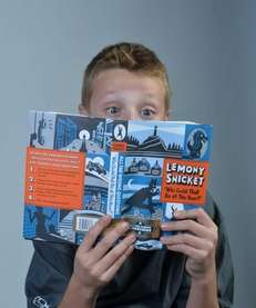 Ryan O'Halloran, 10, of Amityville reads a Lemony