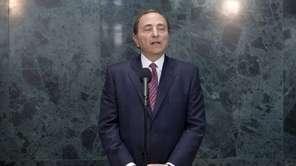NHL commissioner Gary Bettman speaks to reporters following