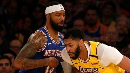 Marcus Morris of the Knicks defends Anthony Davis