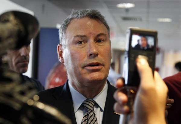 Big East Commissioner Mike Aresco answers a question
