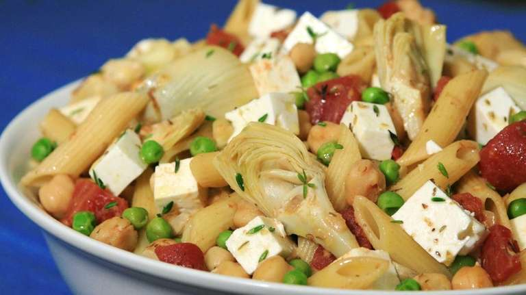 Penne with chickpeas, artichokes, tomato, peas and herbed