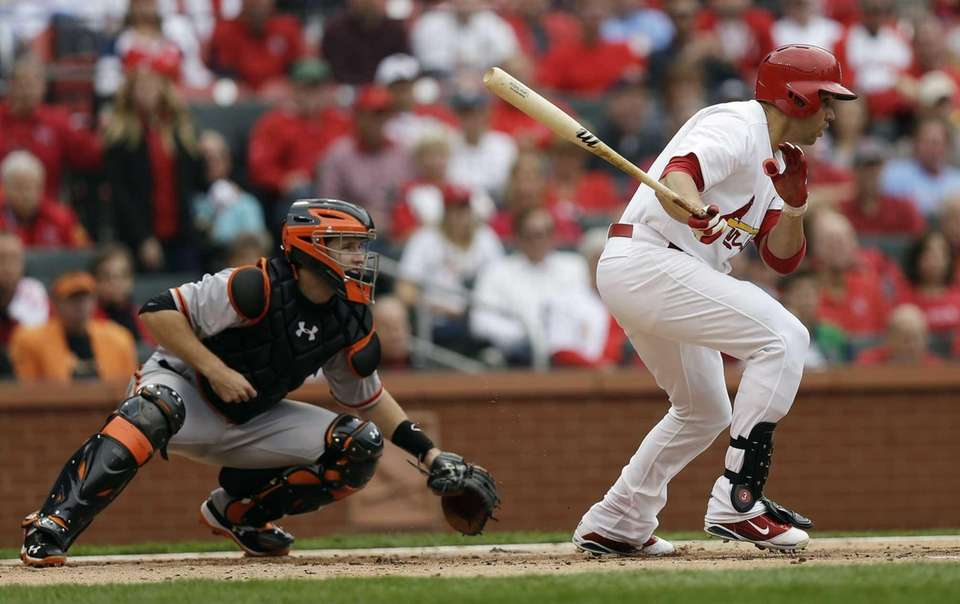 St. Louis Cardinals outfielder Carlos Beltran hits into