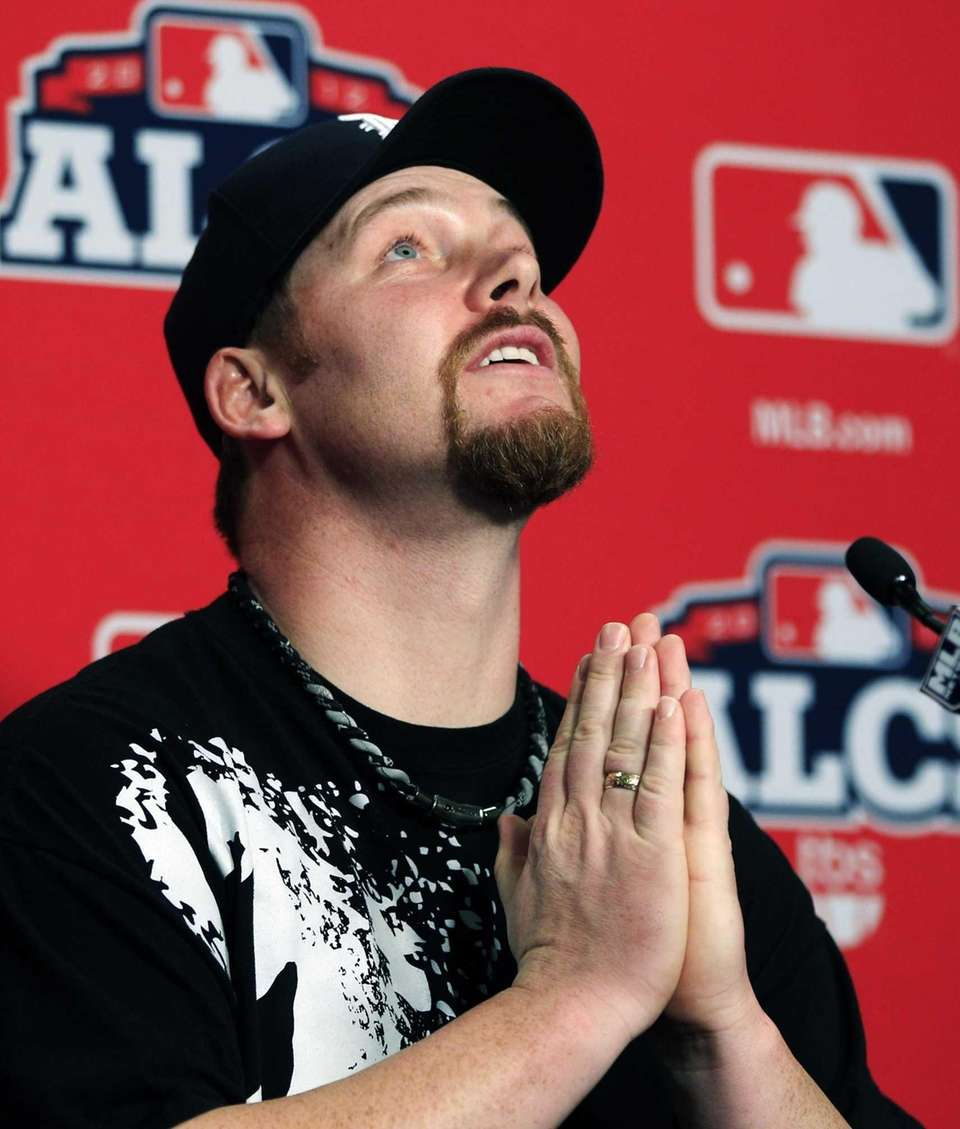 Detroit Tigers pitcher Phil Coke reacts when being