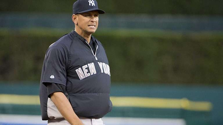 Alex Rodriguez warms up before batting practice before