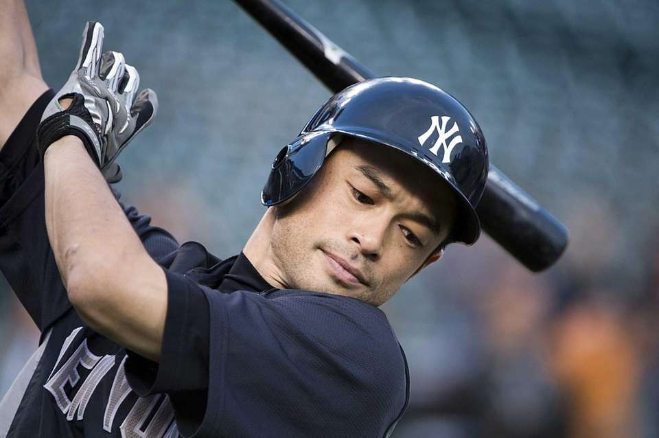 Ichiro Suzuki warms up for batting practice before