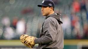 Mark Teixeira looks on during batting practice against