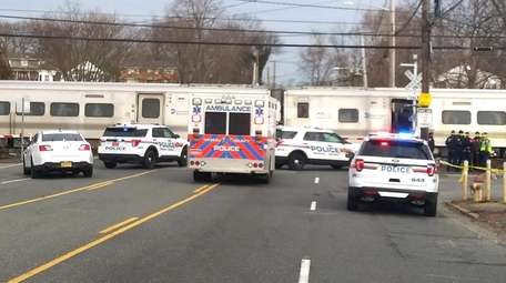 Police and emergency officials at the LIRR Farmingdale