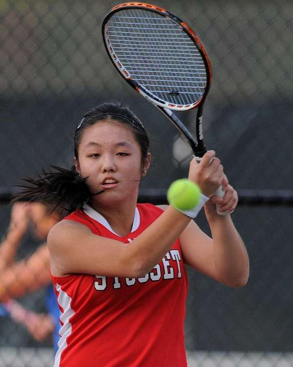 Syosset senior Vivian Cheng returns a volley in