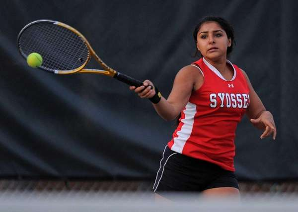 Syosset junior Rhea Malhotra returns a volley in