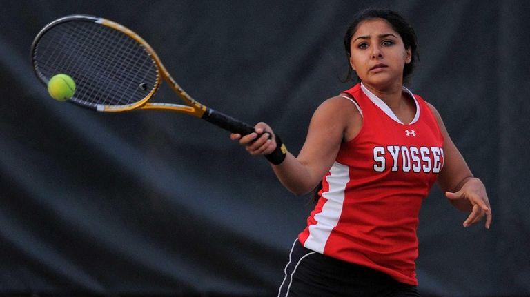 Syosset junior Rhea Malhotra returns a volley in