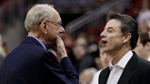 Louisville coach Rick Pitino, right, and his counterpart