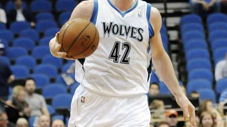 Minnesota Timberwolves forward Kevin Love dribbles during the