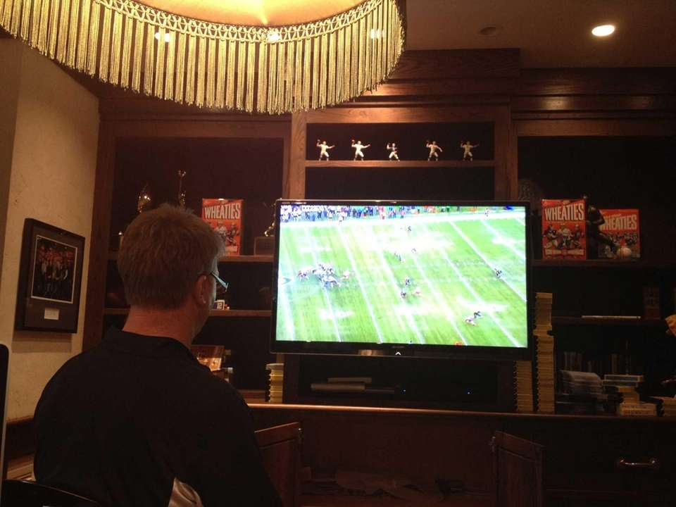 Phil Simms watches game film at his home