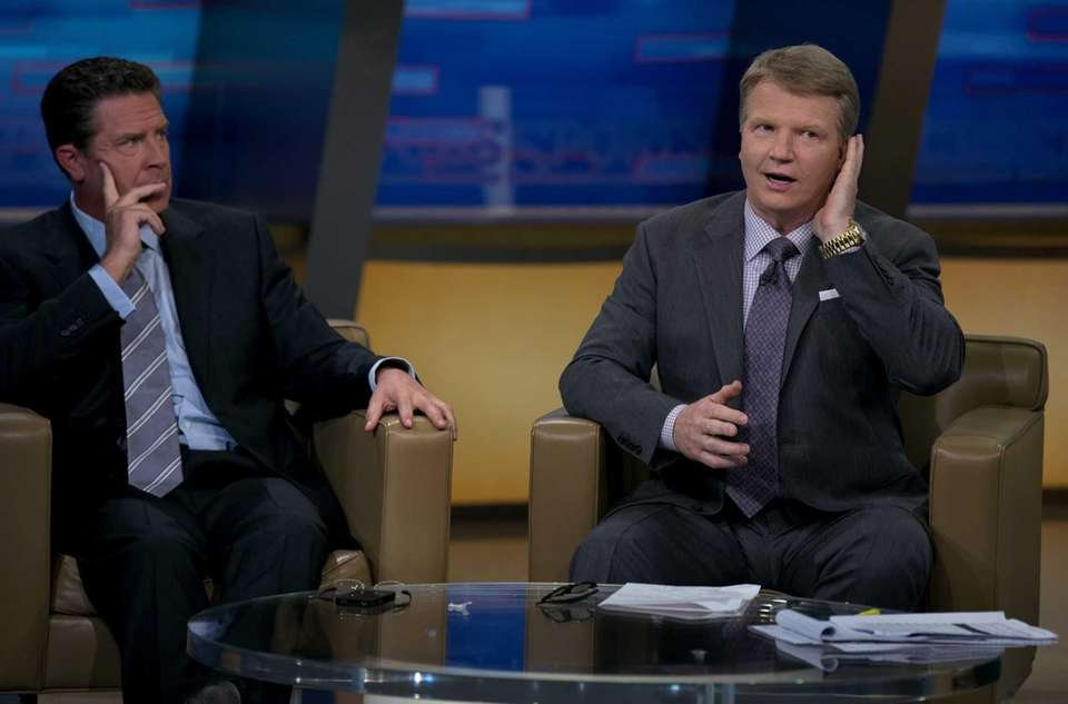 Phil Simms grooms his hair between takes on