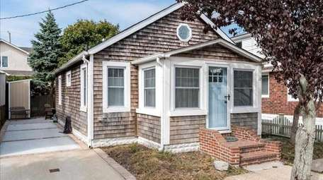 This two-bedroom, one-bathroom cottage in Point Lookout is