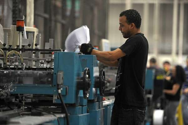 A worker in the Broadridge Financial Solutions plant