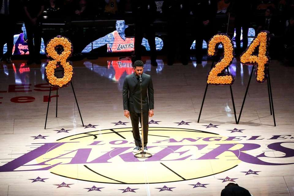 Singer Usher performs during a memorial prior to