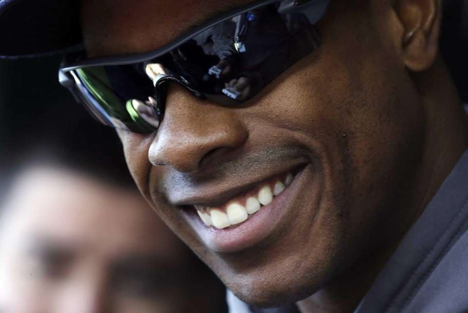 Curtis Granderson listens to a question from the