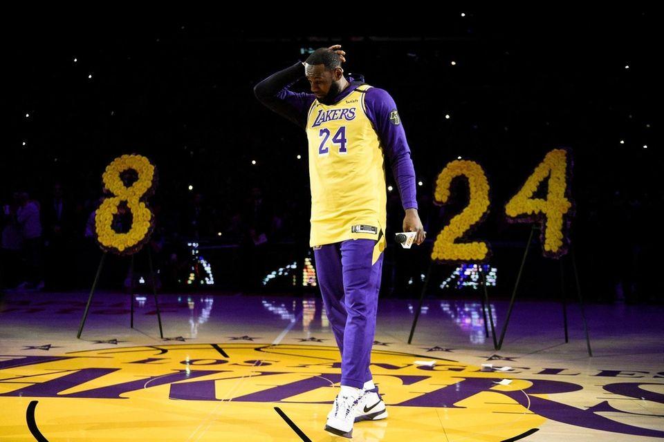 Los Angeles Lakers forward LeBron James looks down