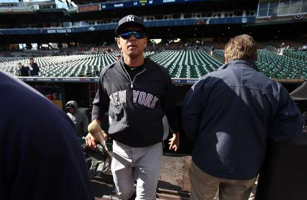 Alex Rodriguez walks out of the dugout and