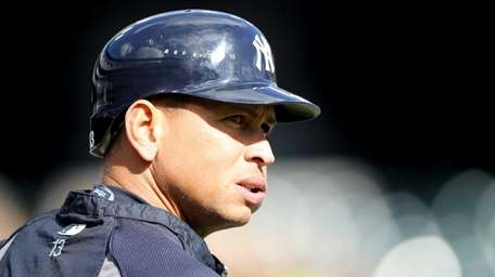 Alex Rodriguez looks on during batting practice during