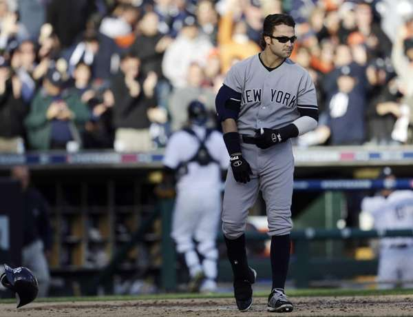 Nick Swisher throws down his helmet after striking