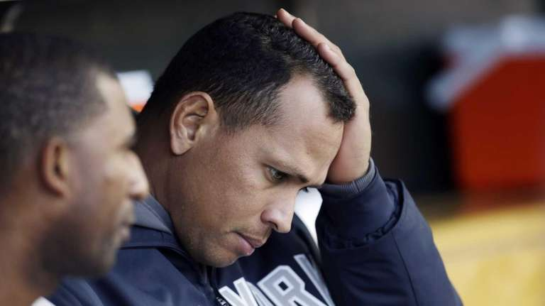 New York Yankees' Alex Rodriguez watches from the